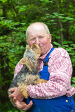 Old man and his dog Stock Photography