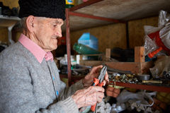 Old man in his tool shed Royalty Free Stock Image