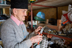 Old man in his tool shed Royalty Free Stock Images