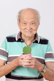 Old man hold pot  leaf heart form Stock Photo