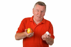 Old man holding egg and apple Royalty Free Stock Photo