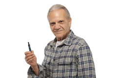 Old man holding Electronic Vapor Cigarette Stock Photo