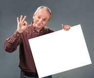 Old man holding empty billboard Stock Photos
