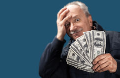 Old man holding group of dollar bills Stock Photos