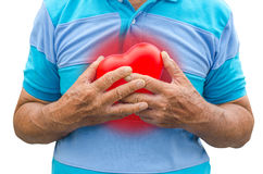 Old man holding heart because of heart infarction Stock Images