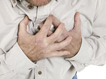 Old man holding his chest Royalty Free Stock Photography