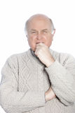 Old man. Holding his chin isolated on a white background Stock Photos