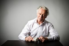 Old man holding piggy bank. Senior man holding piggy bank. Financial security planning concept Royalty Free Stock Image