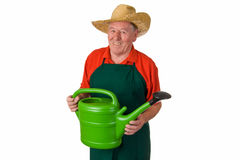 Old man holding watering can Royalty Free Stock Photo