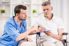 Old man at home. Senior men sitting in wheelchair at home Royalty Free Stock Photos