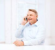 Old man at home with smartphone Stock Photos