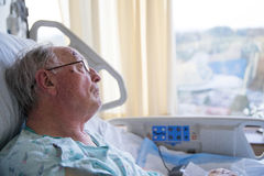 Old man in hospital bed looking up Royalty Free Stock Photos