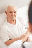 Old man in hospital Stock Images