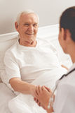Old man in hospital stock photography