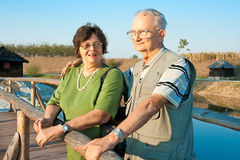 Old man hug his wife on afrernoon sun Stock Photo