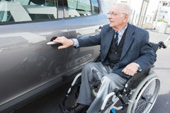 Free Old Man In Wheelchair Next To Car Stock Photos - 95052103
