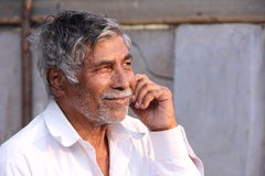 Old Man. Indian Senior Old Man Speaking in Phone Stock Photo