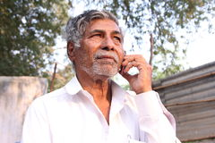 Old Man. Indian Senior Man Speaking in Phone Stock Photos