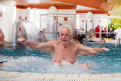 Old man in jacuzzi Stock Images