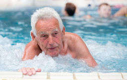 Old man in jacuzzi Royalty Free Stock Images