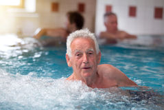 Old man in jacuzzi. Senior man resting in jacuzzi in spa resort royalty free stock image