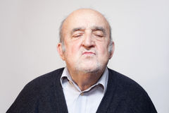 Old man kissing Stock Images