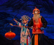 """The old man with the lamp- Beijing Opera"""" Women Generals of Yang Family"""". This opera tells a patriotic story how does an old woman of a hundred years royalty free stock photography"""