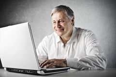 Old Man Laptop. Old man using a laptop computer stock photo