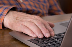 Old man with laptop Royalty Free Stock Image