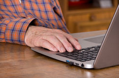 Old man with laptop Stock Image