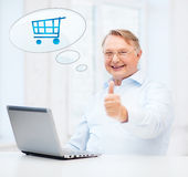 Old man with laptop computer showing thumbs up Stock Images