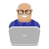 Old man at a laptop Stock Photography