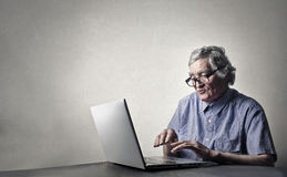 Old man with a laptop Stock Photo