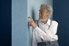 Old man leaning on a wall Royalty Free Stock Photos
