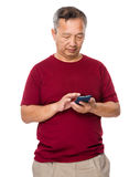Old man learn to use of cellphone Royalty Free Stock Images