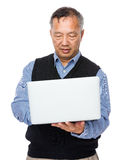 Old man learn to use laptop computer Stock Photos