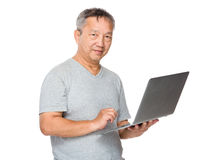 Old man learn to use of notebook computer Royalty Free Stock Photos