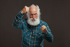Old man with a long beard with big smile. On a dark background royalty free stock photos