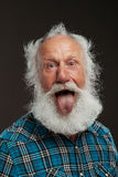 Old man with a long beard wiith big smile. On a black background stock image