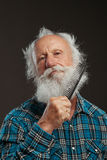 Old man with a long beard wiith big smile. On a black background royalty free stock photography