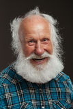 Old man with a long beard wiith big smile. On a white background Royalty Free Stock Photo