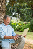 Old man looking at his laptop Royalty Free Stock Photos