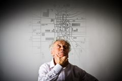 Old man is looking for a route on the city map. Amnesia concept Stock Photos