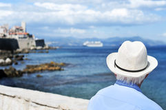 Old man looking at the sea in Antibes, France, filtered Royalty Free Stock Photo