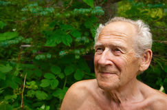 Old Man Looking Up. Face portrait of a cheerful smiling senior man looking up Stock Photo
