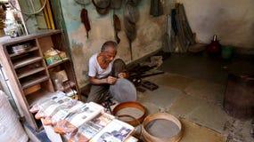 Old Man Making Sieve At Mumbai Street, India Royalty Free Stock Photography