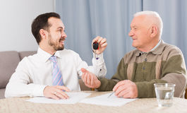 Old man and manager signed contract car lease Royalty Free Stock Image