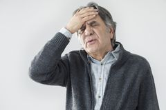 Old man measuring his fever. Old man  measuring his fever Royalty Free Stock Image