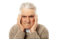 Old man with migraine Royalty Free Stock Photo