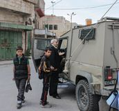 Old man at Military mobile checkpoint in West Bank or Gaza. Old man is hold up by a mobile checkpoint of the Israeli defense force in West Bank or Gaza stock image